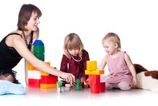 Children With Mother Playing With Blocks Stock Image
