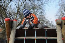 Free Boy Getting Over Barrier Royalty Free Stock Images - 18713129
