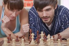 Couple Playing Chess Game Stock Images