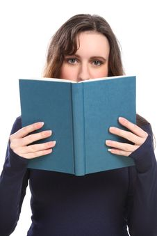 Free Young Woman Reading Holding Book Up To Her Face Stock Photo - 18715210
