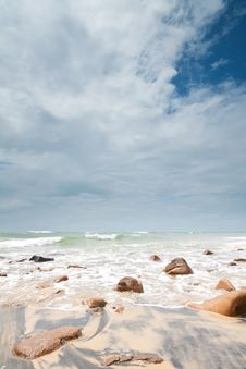 Big Clouds Over Rocks On The Beach Stock Photography