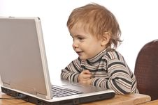 Free Little Child And Laptop. Stock Photography - 18716602