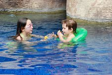 Boy And Girl In Pool Playing Together Stock Image