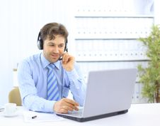 Closeup Of A Businessman With Headset Royalty Free Stock Photography