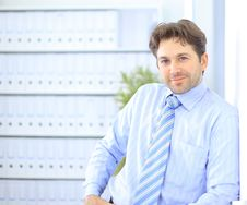 Young Businessman Standing In Office Stock Photos