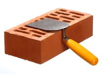 Free Trowel And A Brick Stock Images - 18722554