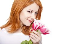 Free Beautiful Red-haired Girl With Tulips. Stock Images - 18722874