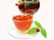 Free Fruit Red Tea With Ripe Raspberry Pouring Stock Photo - 18724560