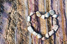 Free Stone Heart On Colourfull Rock Background Royalty Free Stock Photo - 18724785