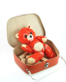 Old Teddy Bear And Suitcase Royalty Free Stock Image