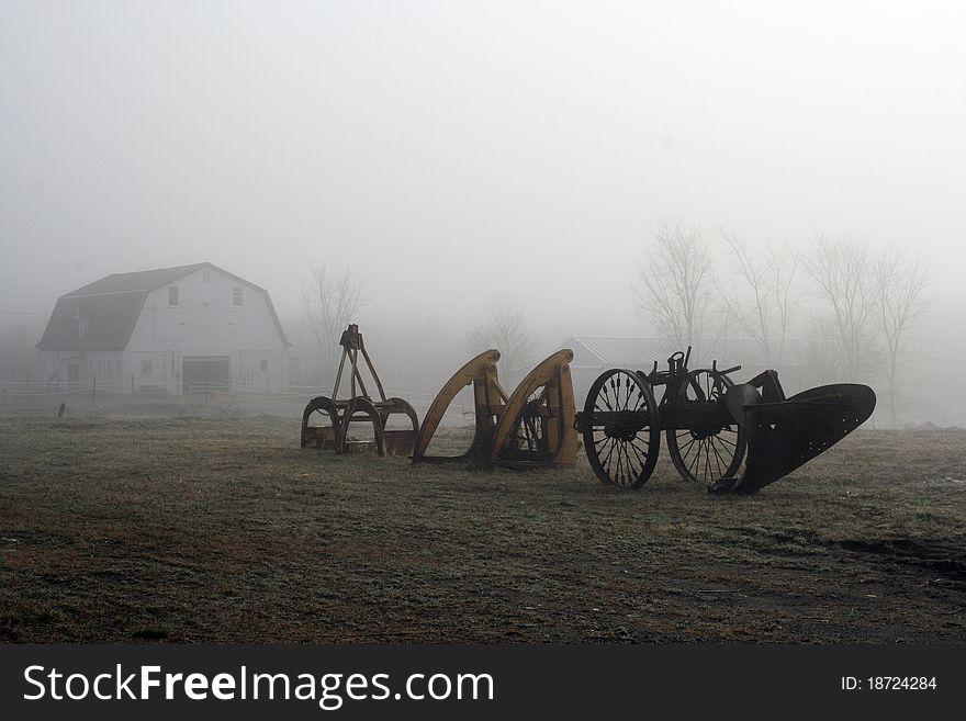 Farm equipment in foggy field