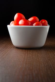 Free A Bowl Of Cherry Tomatoes On A Wood Table. Stock Image - 18731161