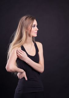 Young Tall Blond Girl In Black Tank Top Stock Photo