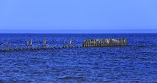 Old Wooden Pier In The Sea. Royalty Free Stock Photo