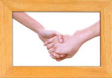 Holding Hands In Wood Frame Isolated