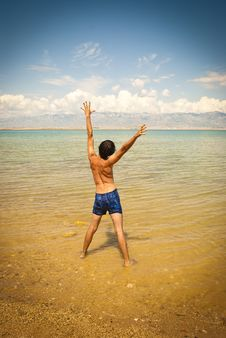 Young Happy Man At The Beach Stock Image