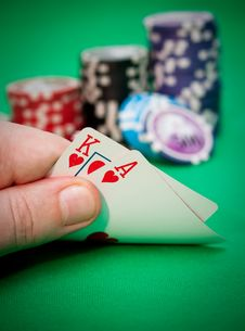 Free Poker Chips And A Hand Flip The Cards Stock Photo - 18739610