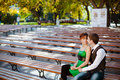 Free Couple Sitting Together On Park Bench Royalty Free Stock Photo - 18747255