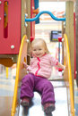 Free Adorable Baby Sliding Down Slide On Playground Royalty Free Stock Photo - 18747765