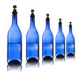 Free Five Blue Glass Bottles With Water Stock Image - 18748831