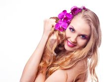 Free Woman With An Orchid Stock Image - 18741281
