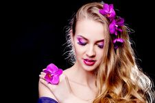 Free Woman With An Orchid Royalty Free Stock Photos - 18741408
