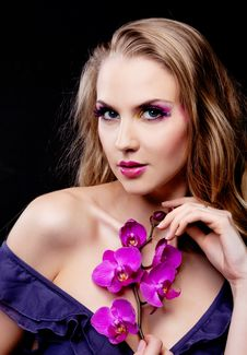 Free Woman With An Orchid Stock Photo - 18741480