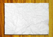 Free White Crumpled Paper On Wood Stock Images - 18747444