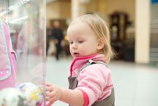 Free Adorable Baby Looking To Baby Toys In Shop Window Stock Photos - 18747613