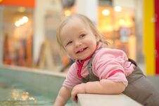Free Adorable Girl Playing In A Public Fountain Stock Photo - 18747720