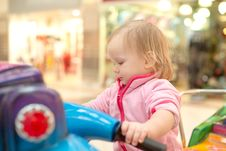 Adorable Baby Ride On Baby Motorcycle Stock Image