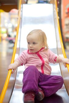 Free Adorable Baby Sliding Down Baby Slide Stock Photography - 18747772