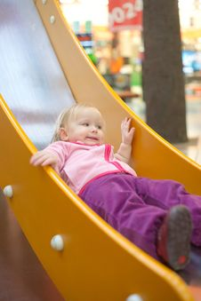 Adorable Baby Sliding Down Baby Slide Stock Images