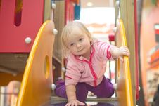 Free Adorable Baby Prepare To Slide Down On Playground Stock Image - 18747781