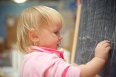 Adorable Baby Draw On Blackboard With Chalk Royalty Free Stock Photo