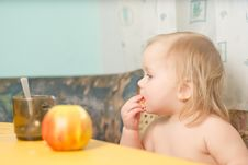 Free Adorable Baby Eat Bread While Drink Tea Stock Photos - 18747853
