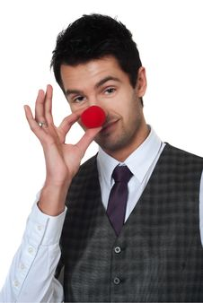 Free Young Man Magican Making Clown Nose Royalty Free Stock Image - 18748476