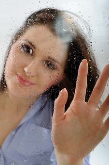 Pretty Lonely Girl Looking Throw The Rainy Window Stock Images