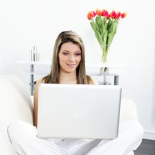 Free Woman On Sofa With Computer Royalty Free Stock Images - 18748759