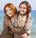 Free Two Happy Girls At Spring Beach. Royalty Free Stock Images - 18755139