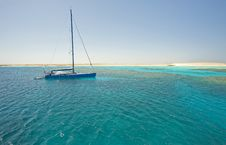 Large Sailing Yacht In A Tropical Lagoon Stock Photos