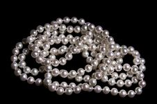 Pearl Beads On A Black Stock Photography