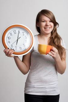 Free Portrait Of A Girl With A Cup And A Clock Stock Image - 18752961
