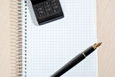 Phone And Notepad Stock Image