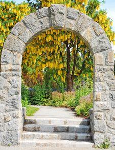 Stone Archway In Garden Stock Images