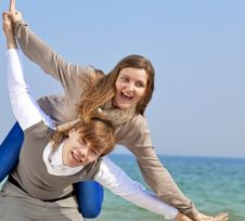 Young Couple Having Fun On The Beach. Stock Photo