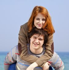 Young Couple Having Fun On The Beach. Stock Images
