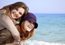 Two Happy Girls At Spring Beach. Stock Photo