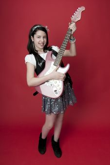 Free Girl Playing Electric Guitar Royalty Free Stock Photo - 18757645