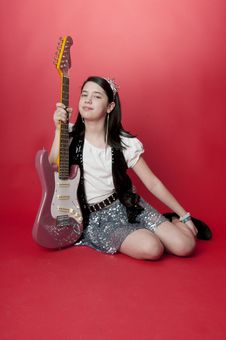 Free Girl With Electric Guitar Royalty Free Stock Image - 18757726